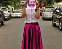 A employee of a human rights organization holding a photo of Lim Mony