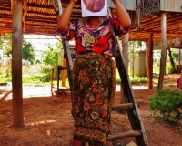 A preview member of the Borei Keila community (that faced forced eviction) holding a photo of Nay Vanda